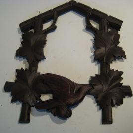 Koekoeksklok voorfront  met vogel donker bruin